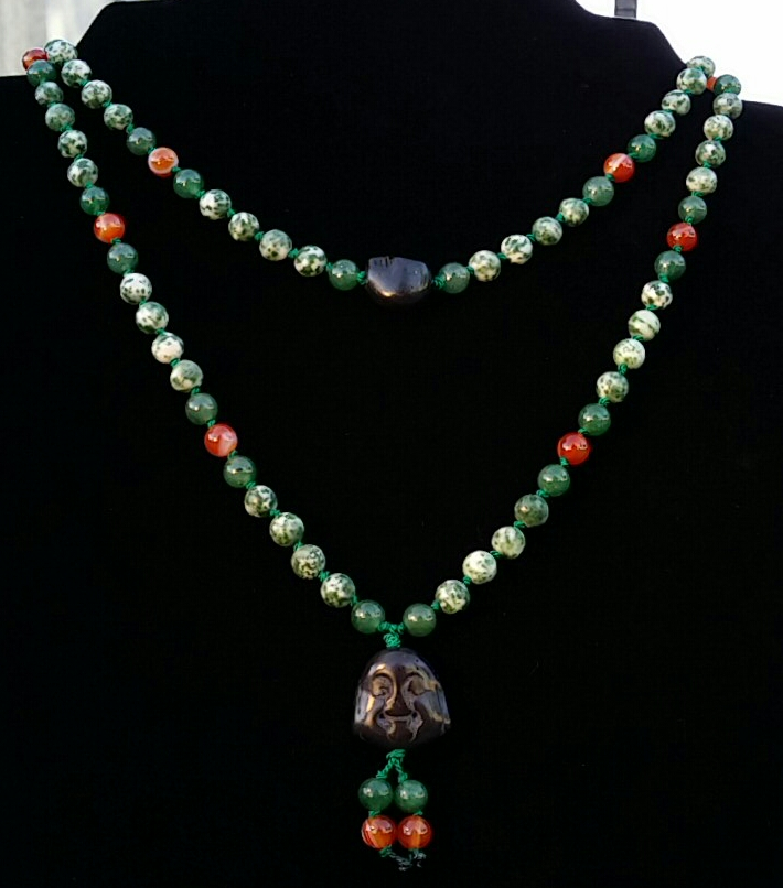 $40.00 ~ Free Shipping                                                                                                   6mm Green and White Spotted Tree Agate, Aventurine,  Fire Agate, and Carnelian natural semi precious stone beads, black Magnesite Skulls and Buddha. Each Mala consists of 108 beads, is strung on natural silk bead cord, and hand-knotted.